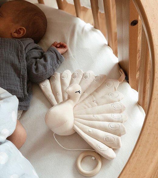 Babyshop - Spieluhr Pfau